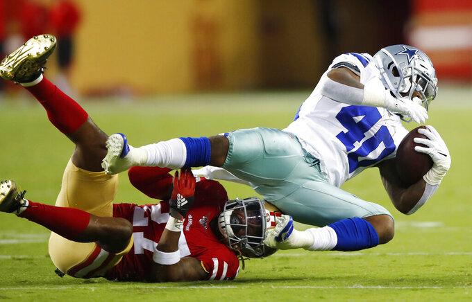 Dallas Cowboys running back Mike Weber (40) is tackled by San Francisco 49ers free safety Adrian Colbert during the second half of an NFL preseason football game in Santa Clara, Calif., Saturday, Aug. 10, 2019. (AP Photo/John Hefti)