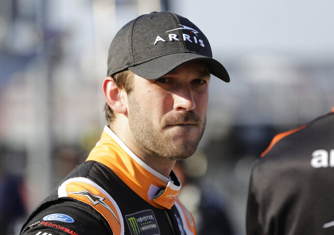 Daniel Suarez looks down pit road before qualifying for Saturday's NASCAR All-Star Cup series auto race at Charlotte Motor Speedway in Concord, N.C., Friday, May 17, 2019. (AP Photo/Chuck Burton)