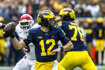 Michigan quarterback Cade McNamara (12) throws a pass in the second quarter of an NCAA college football game against Rutgers in Ann Arbor, Mich., Saturday, Sept. 25, 2021. (AP Photo/Tony Ding)
