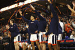 Virginia players celebrate a score during an NCAA college basketball game against Clemson on Wednesday, Feb. 5, 2020, in Charlottesville, Va. (Erin Edgerton/The Daily Progress via AP)