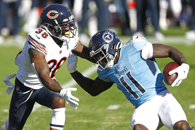 Tennessee Titans wide receiver A.J. Brown (11) carries the ball against Chicago Bears strong safety Tashaun Gipson (38) in the first half of an NFL football game Sunday, Nov. 8, 2020, in Nashville, Tenn. (AP Photo/Wade Payne)
