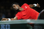 Gael Monfils of France drops his racket when returning a ball against Daniil Medvedev of Russia in the semi-finals of the ABN AMRO world tennis tournament at Ahoy Arena in Rotterdam, Netherlands, Saturday, Feb. 16, 2019. (AP Photo/Peter Dejong)