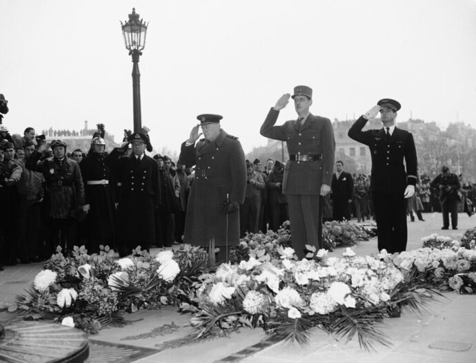 FILE - In this Nov. 12, 1944 file photo, Britain's Prime Minister Winston Churchill, left, and General Charles De Gaulle, centre, salute at France's Unknown Warrior at the Arc De Triomphe in Paris. Though allies in World War II, De Gaulle twice vetoed Britain's application in the 1960s to join what was then known as the European Economic Community. Britain eventually joined in 1973 after De Gaulle's successor, Georges Pompidou, lifted France's veto. On Jan. 31, 2020, Britain is scheduled to leave what became known as the European Union. (AP Photo, File)