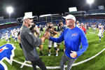 Indianapolis Colts head coach Frank Reich, left, shakes hands with Buffalo Bills head coach Sean McDermott after an NFL preseason football game, Thursday, Aug. 8, 2019, in Orchard Park, N.Y. The Bills defeated the Colts 24-16. (AP Photo/Adrian Kraus)
