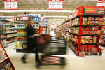 A shopper pushes a cart through the Sagara International Grocery in Columbus, Ohio, on Thursday, Feb. 22, 2018. Immigrants, including refugees, are changing the landscape of Columbus, which, among other things, has the largest Bhutanese population in the United States. The Columbus area also is home to a large concentration of Somali refugees. (AP Photo/Martha Irvine)