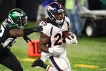 Denver Broncos running back Melvin Gordon (25) runs past New York Jets outside linebacker Alec Ogletree (52) for a touchdown during the second half of an NFL football game Thursday, Oct. 1, 2020, in East Rutherford, N.J. (AP Photo/Seth Wenig)