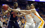 Auburn's Horace Spencer (0) holds the ball away from Tennessee's Admiral Schofield (5) and Grant Williams (2) in the second half of the NCAA college basketball Southeastern Conference championship game Sunday, March 17, 2019, in Nashville, Tenn. (AP Photo/Mark Humphrey)