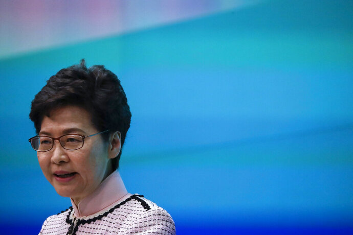 Hong Kong Chief Executive Carrie Lam speaks during a press conference at the Legislative Council in Hong Kong Wednesday, Oct. 16, 2019. In chaotic scenes, furious pro-democracy lawmakers twice forced Hong Kong's leader to stop delivering a speech laying out her policy objectives and clamored for her to resign after she walked out of the legislature on Wednesday and then delivered the annual address 75 minutes late via television. (AP Photo/Mark Schiefelbein)