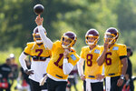 Washington quarterbacks Dwayne Haskins Jr., (7), Kyle Allen (8), and Steven Montez (6), watch as quarterback Alex Smith (11) throws during practice at the team's NFL football training facility, Tuesday, Aug. 25, 2020, in Ashburn, Va. (AP Photo/Alex Brandon)