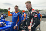 Six-time IndyCar champion Scott Dixon, left, chats with Josef Newgarden after they took a pace car lap at the IndyCar auto race, Friday, Aug. 6, 2021, in Nashville, Tenn. (AP Photo/Dan Gelston)