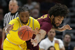 Michigan's Zavier Simpson, left, and Minnesota's Jordan Murphy battle for a loose ball during the first half of an NCAA college basketball game in the semifinals of the Big Ten Conference tournament, Saturday, March 16, 2019, in Chicago. (AP Photo/Kiichiro Sato)