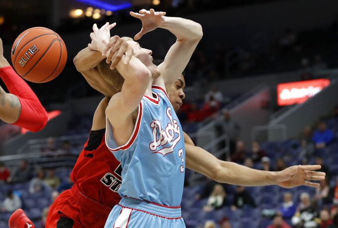 Drake's Garrett Sturtz, front, is fouled on his way to the basket by Illinois State's William Tinsley during the first half of an NCAA college basketball game in the quarterfinal round of the Missouri Valley Conference tournament, Friday, March 8, 2019, in St. Louis. (AP Photo/Jeff Roberson)