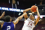 Florida State guard Devin Vassell (24) shoots over North Alabama guard Christian Agnew in the second half of an NCAA college basketball game in Tallahassee, Fla., Saturday, Dec. 28, 2019. (AP Photo/Mark Wallheiser)
