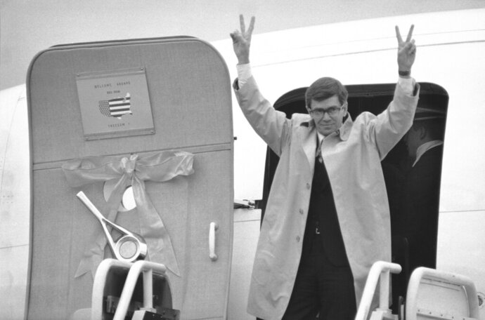 FILE - In this Jan. 27, 1981, file photo Bruce Laingen steps from the first of four planes carrying the freed Iranian hostages from West Point, N.Y., to their official welcome in Washington. Laingen, the top American diplomat at the U.S. Embassy in Tehran when it was overrun by Iranian protesters in 1979 and one of 52 Americans held hostage for more than a year, has died at age 96. He died July 15, 2019, according to his son. (AP Photo)