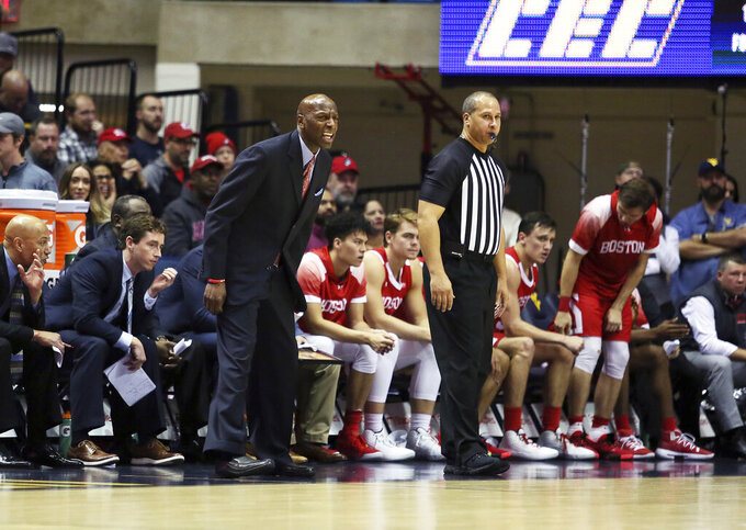 Boston University coach Joe Jones shouts during the first half of the team's NCAA college basketball game against West Virginia on Friday, Nov. 22, 2019, in Morgantown, W.Va. (AP Photo/Kathleen Batten)