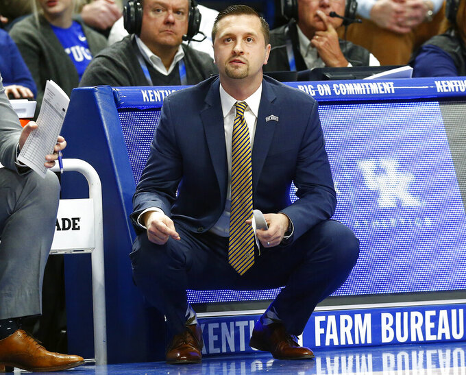 Mount St. Mary's head coach Dan Engelstad watches his team during the first half of an NCAA college basketball game against Kentucky in Lexington, Ky., Friday, Nov. 22, 2019. (AP Photo/James Crisp)