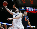 UC Irvine guard Spencer Rivers, left, lays up a shot against Cal State Fullerton forward Johnny Wang, right, during the second half of an NCAA college basketball game for the Big West men's tournament championship in Anaheim, Calif., Saturday, March 16, 2019. UC Irvine won 92-64. (AP Photo/Alex Gallardo)
