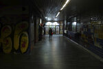 A woman walks through an underground passage during a rainy day in Belgrade, Serbia, Wednesday, Feb. 5, 2020. Weather forecasts predict changeable weather during the next few days. (AP Photo/Darko Vojinovic)
