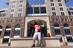 Nebraska fan Charles Allhands, of Los Angele,s poses outside Memorial Stadium before the Huskers play against Buffalo in an NCAA college football game Saturday, Sept. 11, 2021, at Memorial Stadium in Lincoln, Neb. (AP Photo/Rebecca S. Gratz)