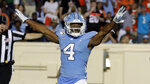 FILE - In this Sept. 7, 2019, file photo, North Carolina's Trey Morrison (4) celebrates after he broke up a long pass during the third quarter of an NCAA college football game against Miami in Chapel Hill, N.C., Saturday, Sept. 7, 2019. Morrison entered preseason camp set to play nickelback, only to start working at free safety with the goal of being ready to play anywhere in the secondary on short notice. That is because the 18th-ranked Tar Heels, like many teams, are preparing for roster uncertainty sure to come amid the coronavirus pandemic. Positive tests, contact tracing and quarantines could abruptly alter any roster along with the injury risk that has long been part of the game. (AP Photo/Chris Seward, File)