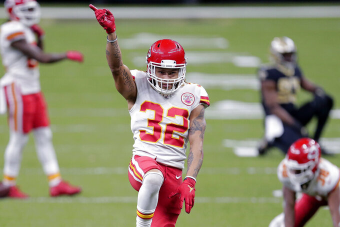 Kansas City Chiefs strong safety Tyrann Mathieu (32) reacts after a pass breakup in the second half of an NFL football game against the New Orleans Saints in New Orleans, Sunday, Dec. 20, 2020. (AP Photo/Brett Duke)