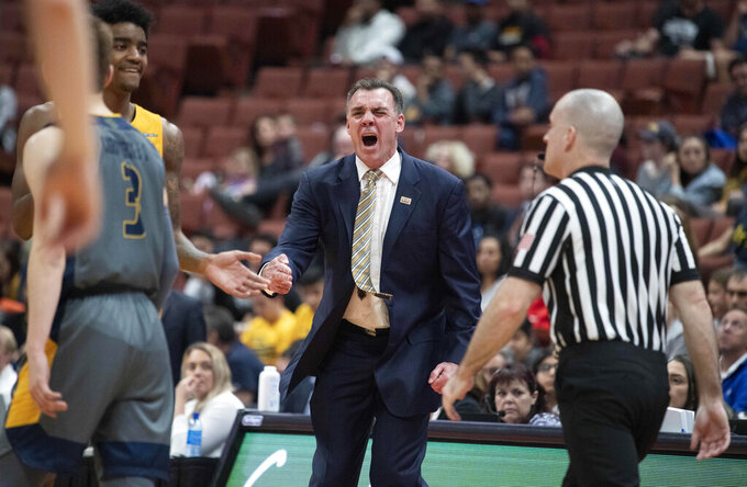 UC Irvine coach Russell Turner, center, reacts after a foul was called on the team during the first half of an NCAA college basketball game against Long Beach State at the Big West men's tournament in Anaheim, Calif., Friday, March 15, 2019. (AP Photo/Kyusung Gong)