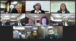 In this image from video released by Malaysian Judiciary, Meabh Quoirin and Sebastian Quoirin, center frame, mother and father of missing schoolgirl Nora Anne Quoirin, attend the verdict for inquest into the death of the Irish-French teenager, Monday, Jan. 4, 2021. A Malaysian coroner ruled Monday, Jan. 4, 2021 the death of the French-Irish teen, whose body was found near a Malaysian jungle resort where she vanished while on holiday, was most likely a misadventure that didn't involve other people. (Malaysian Judiciary via AP)