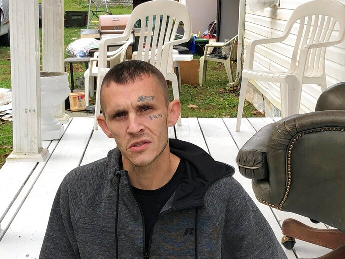 In this Oct. 30, 2019 photo, Joshua Bessey discusses what happened to him in September at the Gallia County Jail in southern Ohio, during an interview in Vinton, Ohio. Bessey says a sheriff's deputy pushed him over while he was strapped in a restraint chair, causing serious injuries that led to him being flown to a Columbus hospital where he was in a coma for four days. (AP Photo/Mark Gillispie)