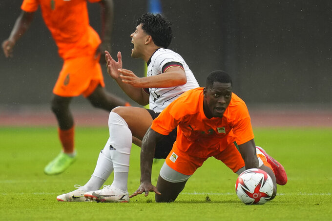 Ivory Coast's Kader Keita, front, and Germany's Nadiem Amiri fight for the ball during a men's soccer match at the 2020 Summer Olympics, Wednesday, July 28, 2021, in Rifu, Japan. (AP Photo/Andre Penner)
