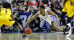 Buffalo's CJ Massinburg (5) and Arizona State's Luguentz Dort (1) chase a loose ball during the first half of a first round men's college basketball game in the NCAA Tournament Friday, March 22, 2019, in Tulsa, Okla. (AP Photo/Charlie Riedel)