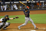 Boston Red Sox's Kevin Plawecki hits a single during the sixth inning of a baseball game against the Miami Marlins, Thursday, Sept. 17, 2020, in Miami. (AP Photo/Gaston De Cardenas)