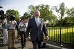 Agriculture Secretary Sonny Perdue laughs with a reporter on the North Lawn of the White House in Washington, Thursday, May 23, 2019.(AP Photo/Andrew Harnik)