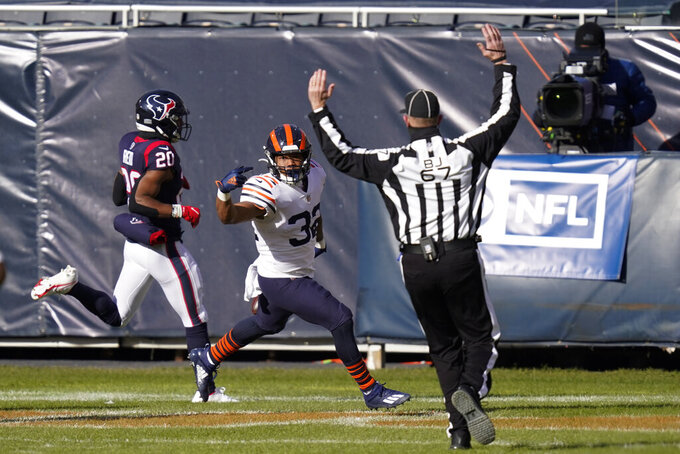 Chicago Bears' David Montgomery (32) reacts after a touchdown run during the first half of an NFL football game against the Houston Texans, Sunday, Dec. 13, 2020, in Chicago. (AP Photo/Charles Rex Arbogast)