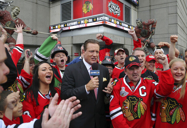 FILE - In this Monday, June 8, 2015 file photo, Former Chicago Blackhawk player Jeremy Roenick is surrounded by fans before Game 3 of the NHL hockey Stanley Cup Final against the Tampa Bay Lightning  in Chicago. Jeremy Roenick will not be returning to NBC Sports after his suspension for making inappropriate comments about coworkers. A network spokesman confirmed to The Associated Press that Roenick will not be back on the air, Wednesday, Feb. 12, 2020. (John Starks/Daily Herald via AP, File)