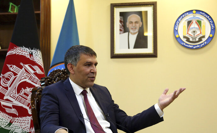 Afghan Interior Minister Massoud Andarabi gives an interview at the Ministry of the Interior in Kabul, Afghanistan, Sunday, Sept. 22, 2019. Andarabi said Sunday that police make up 70% of the casualties among security forces in relentless attacks by Taliban and Islamic State insurgents. He said a slow, steady overhaul is underway. (AP Photo/Rahmat Gul)