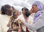 A young child is screened for malnutrition by World Food Programme (WFP) workers in the Adi Daero district of the Tigray region of northern Ethiopia Saturday, Aug. 21, 2021. (Claire Nevill/WFP via AP)