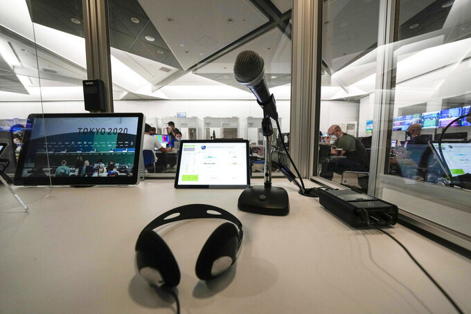 A console of interpreters at the main press center, at the 2020 Summer Olympics, Friday, July 30, 2021, in Tokyo, Japan. Unlike previous Olympics, all the interpretation is being done remotely with most interpreters working in booths at the main center. Their simultaneous translation can be accessed at all Olympic venues on an app. This eliminates interpreters getting tied up in traffic heading to an venue. (AP Photo/Luca Bruno)