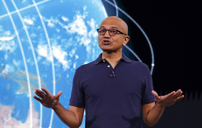 FILE - In this May 6, 2019 file photo, Microsoft CEO Satya Nadella delivers the keynote address at Build, the company's annual conference for software developers in Seattle. Microsoft and other tech giants have been competing to strike lucrative partnerships with ExxonMobil, Chevron, Shell, BP and other energy firms. One employee stood up to ask Microsoft CEO Nadella about the ethics of the company's oil and gas contracts at an all-staff meeting in Sept. 2019, and Nadella defended the partnerships. (AP Photo/Elaine Thompson, File)