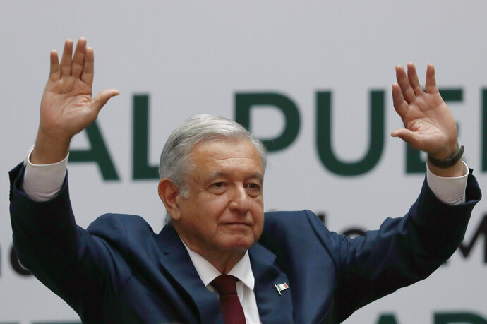 Mexican President Andrés Manuel López Obrador waves goodbye after delivering his first year's state of the nation address at the National Palace in Mexico City, Sunday, Sept. 1, 2019. (AP Photo/Marco Ugarte)