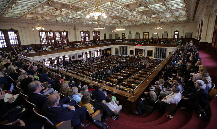 FILE - In this Tuesday, Feb. 5, 2019 file photo, A full gallery oversees the Texas Gov. Greg Abbott giving his State of the State Address in the House Chamber in Austin, Texas. Two years ago, a longtime Republican incumbent held onto his west Houston state House seat by the slimmest of margins, a mere one-tenth of percentage point in a race that helped the GOP withstand a Democratic wave. This year, the stakes are even higher. AP Photo/Eric Gay)