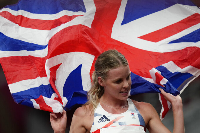 Keely Hodgkinson, of Britain, celebrates after her second place finish in the final of the women's 800-meters at the 2020 Summer Olympics, Tuesday, Aug. 3, 2021, in Tokyo. (AP Photo/Petr David Josek)