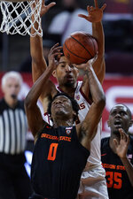 Oregon State guard Gianni Hunt (0) shoots in front of Southern California forward Isaiah Mobley during the first half of an NCAA college basketball game Thursday, Jan. 28, 2021, in Los Angeles. (AP Photo/Ashley Landis)