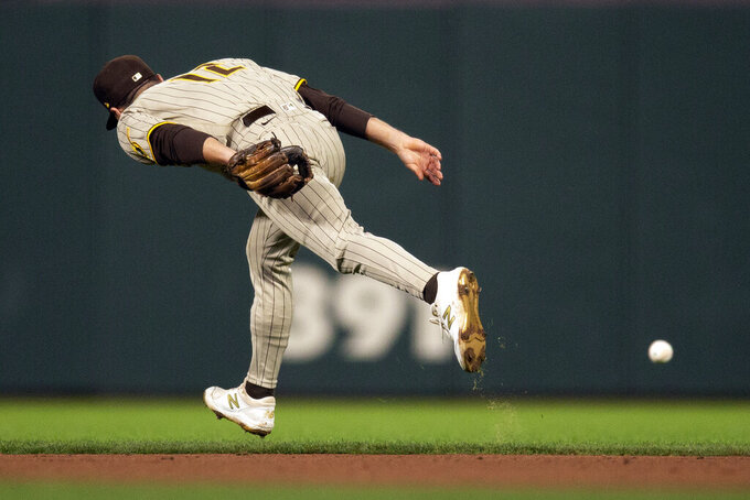 San Diego Padres second baseman Adam Frazier can't get to an RBI single by San Francisco Giants' Tommy LaStella during the fourth inning of a baseball game, Tuesday, Sept. 14, 2021, in San Francisco. (AP Photo/D. Ross Cameron)