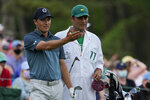 FILE - In this  Sunday, April 11, 2021 file photo, Jordan Spieth discusses his tee shot with his caddie Michael Greller on the 12th hole during the final round of the Masters golf tournament, in Augusta, Ga. Spieth says he tested positive for the coronavirus three weeks ago. That led to a month break after the Masters. (AP Photo/David J. Phillip, File)