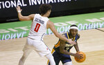 Toledo guard Marreon Jackson (3) looks to pass the ball as Richmond guard Jacob Gilyard (0) defends during the first half of an NCAA college basketball game in the first round of the NIT, Wednesday, March 17, 2021, in Denton, Texas. (AP Photo/Ron Jenkins)