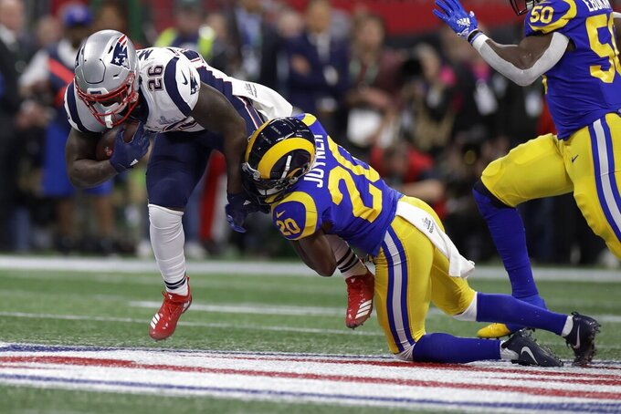 New England Patriots' Sony Michel (26) is tackled by Los Angeles Rams' Lamarcus Joyner (20) during the first half of the NFL Super Bowl 53 football game Sunday, Feb. 3, 2019, in Atlanta.(AP Photo/Carolyn Kaster)