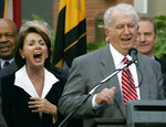 FILE - In this Jan. 5, 2007 file photo, Speaker of the House Nancy Pelosi, D-Calif., left, laughs as her brother Thomas D' Alesandro III, right, makes a joke as he introduces her husband Paul, during a street renaming ceremony in her behalf, in Baltimore. A spokesman for Pelosi said D'Alesandro died Sunday, Oct. 20, 2019, he was 90. (AP Photo/Chris Gardner, File)