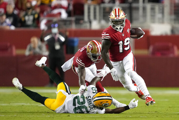 San Francisco 49ers wide receiver Deebo Samuel (19) runs past Green Bay Packers free safety Darnell Savage (26) during the second half of an NFL football game in Santa Clara, Calif., Sunday, Sept. 26, 2021. (AP Photo/Tony Avelar)