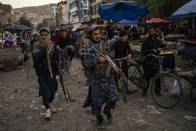 Taliban fighters patrol a market in Kabul's Old City, Afghanistan, Tuesday, Sept. 14, 2021. It is feared Afghanistan could further plunge toward famine and economic collapse after the chaos of the past month, which saw the Taliban oust the government in a lightning sweep as U.S. and NATO forces exited the 20-year war. (AP Photo/Bernat Armangue)