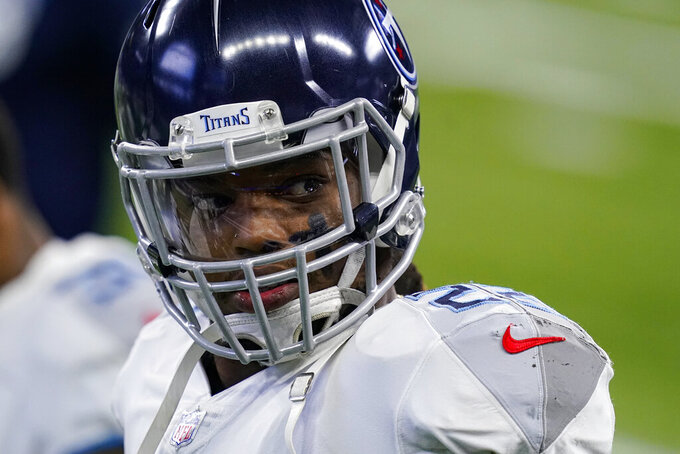 FILE - In this Nov. 29, 2020, file photo, Tennessee Titans running back Derrick Henry (22) watches before an NFL football game against the Indianapolis Colts in Indianapolis. Fresh off becoming just the eighth man to run for at least 2,000 yards, Henry now has a 17th game giving him a chance at Eric Dickerson's league record of 2,105 yards set in 1984. (AP Photo/Darron Cummings, File)
